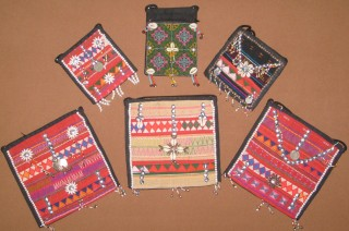 Hand embroidered and beaded purses